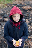 Homeless boy holds cookies in hand Royalty Free Stock Photography