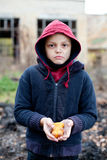 Homeless boy holds cookies in hand Stock Photo