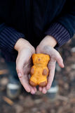 Homeless boy holds cookies in hand. The homeless boy holds cookies in hand Royalty Free Stock Photos
