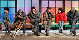 Homeless at the bus station. Royalty Free Stock Photo