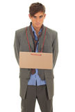 Homeless businessman with blank card Stock Image
