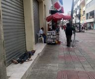 Homeless child sleeping on El Conde street in Zona Colonial Royalty Free Stock Photography