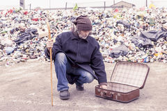 Homeless collects alms from the suitcase Royalty Free Stock Image