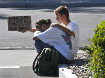 Homeless Couple. Asking for help on driveway in a urban city