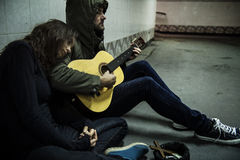 Homeless Couple Man Playing Guitar Asking For Money Donation Royalty Free Stock Photography