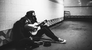 Homeless Couple Man Playing Guitar Asking For Money Donation Stock Images