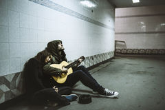 Homeless Couple Man Playing Guitar Asking For Money Donation Stock Photography