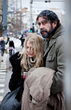Homeless couple struggle city centre Royalty Free Stock Photography