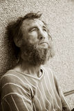 Homeless in despair. Homeless old man in depression royalty free stock image