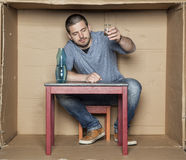 Homeless drink alcohol to feel better Royalty Free Stock Photos