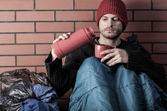 Homeless drinking hot tea Royalty Free Stock Images