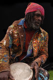 Homeless Drummer. Colorful homeless drummer with dreadlocks stock image