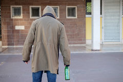Homeless drunk and  alcohol addicted walking alone Stock Photography