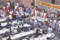 Homeless eating Christmas dinners. Los Angeles, California Royalty Free Stock Photography
