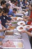 Homeless eating Christmas dinners Royalty Free Stock Photo