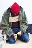 Homeless eating his meal Royalty Free Stock Image