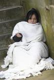 Homeless Girl Sleeping Rough. On steps Stock Images