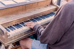 A homeless guy playing piano in the middle of street Royalty Free Stock Photo