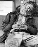 Homeless guy sleeping on a bench