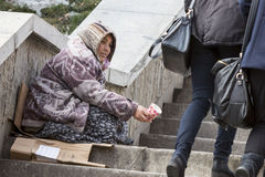 Homeless gypsy woman begging for money Stock Image
