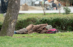 Homeless half-naked man sleeping in the park Royalty Free Stock Image