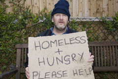 Homeless hungry man. Homeless and hungry man on park benchman royalty free stock images