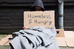 Homeless And Hungry Man. Sitting On Street With Signboard Stock Photography
