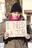 Homeless job. Homeless with cardboard looking for a job Royalty Free Stock Photos