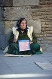 A homeless lady begging for alms in the streets of SEville. This is a tomeless and poor begar beging for alms in the streets of Seville Stock Image