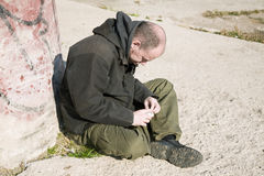 Homeless life. Special toned photo f/x, focus point on face royalty free stock photo
