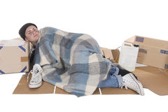 Homeless lying on cardboard Royalty Free Stock Photos