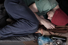 Homeless lying on the cardboard Royalty Free Stock Photography