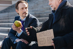 Homeless male telling his life story to stranger Royalty Free Stock Photography