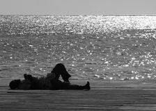 The Homeless Man. Laying down by the sea on the hot day in Bridgetown, Barbados Royalty Free Stock Photography