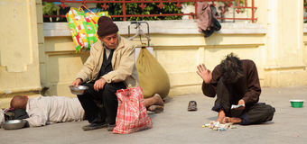 Homeless man. An old Homeless man counts his money in Canton, China Stock Photography