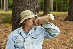 Homeless man. With his bottle in a park royalty free stock images