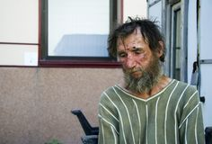 Homeless man. On a city street royalty free stock photography