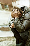 Sad homeless man in despair Stock Image