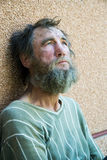 Homeless man. Poor homeless beggar in despair Royalty Free Stock Photography