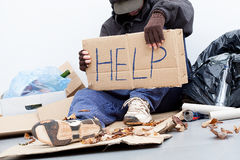 Homeless man asking for a help. Homeless man with a cardboard asking for a help Stock Images