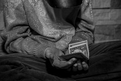 Homeless man asks for money. From passers-by on the streets Royalty Free Stock Photo