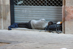 Homeless Man. A Homeless Man asleep in a city doorway Royalty Free Stock Photography