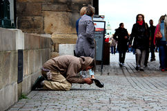 The homeless man begging for some money Royalty Free Stock Photo