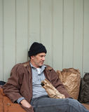 Homeless Man with Belongings on the Street royalty free stock photo