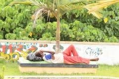 Homeless man on bench Stock Photos
