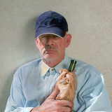 Homeless man with bottle. MAUI, HAWAII-JAN. 2007: A depressed homeless man hugging a wine bottle to his chest Royalty Free Stock Image