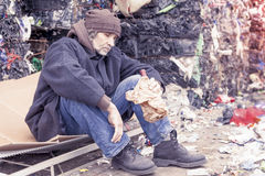 Homeless man with a bottle of red wine Royalty Free Stock Image