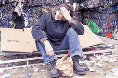 Homeless man with a bottle of red wine Royalty Free Stock Images