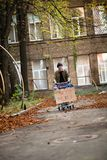 Homeless man in city street, shopping cart with board need money. Stock Images