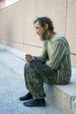 Sad homeless man in depression